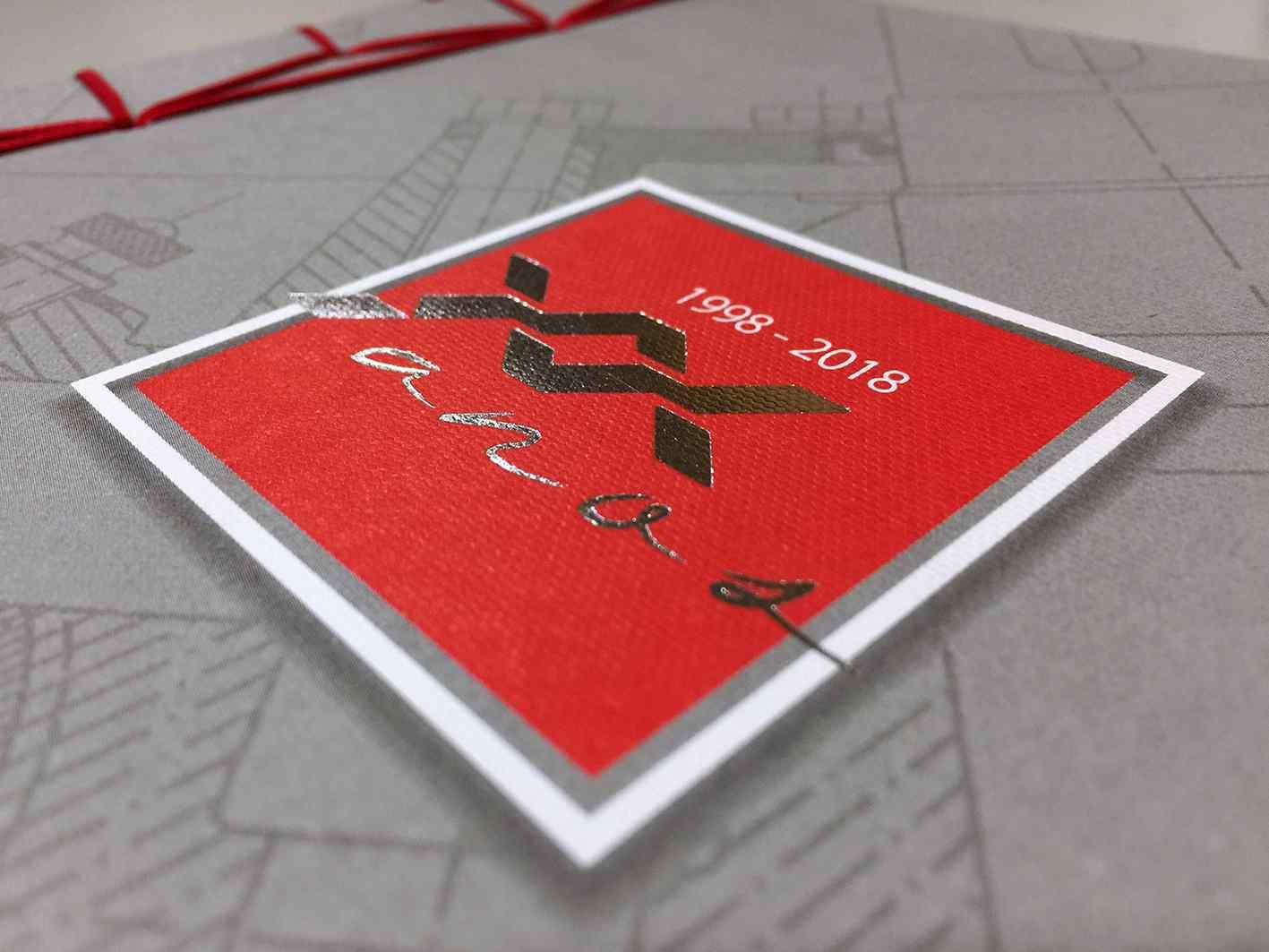 acabamento costura artes gráficas com capa estampada
